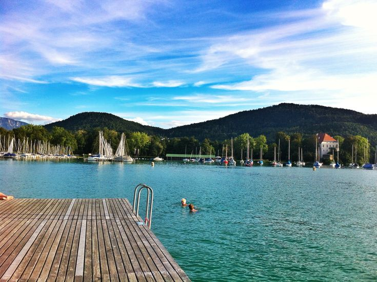 People swimming in the beautiful Lake Wörthersee, Klagenfurt
