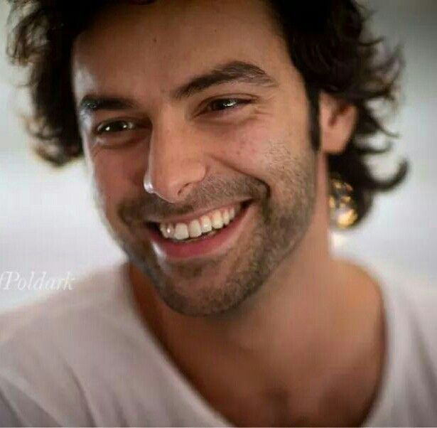 Aidan Turner and his radiant smile.