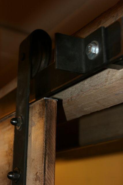 18 best sliding media wall hider images on pinterest for Cheap barn door hardware