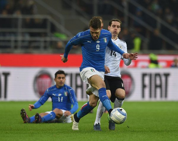 Andrea Belotti of Italy of Italy (L) competes for the ball with Sebastian Rudy of Germany during Friendly Match between Italy and Germany at Giuseppe Meazza Stadium on November 15, 2016 in Milan, .