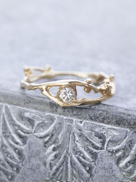 Our ethereal Gold branch ring features a sparkling, precious Champagne Diamond…