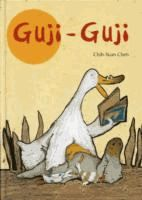 One day, an extra-large egg rolls right into Mother Duck's nest. Her hatchlings include a yellow duckling; one with blue spots; another with brown stripes; and a rather unusual, crocodile-shaped youngster, named after his first words. Guji Guji grows bigger and stronger than his siblings (and more crocodilelike), but Mother loves all her offspring the same. When three duck-hungry crocodiles make fun of Guji Guji's ways and try to tempt him into betraying his family, he is put to the test…