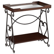 Bombay® Claudia Console Table - The perfect mixture of metal, wood and glass gives the Claudia console table both style and substance that you'll quickly appreciate. Whether for display purposes, serving needs--or both--the fixed lower shelf and glass-lined tray top provide ample space while the hand-forged decorative detailing gives it charm and character that everyone will enjoy.