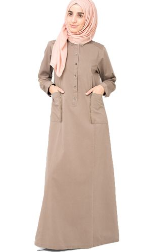 For quieter days, a solid design can be best and this beige jilbab with button front details is a great choice. Button Front  Deep patch pockets  Color - Tan Beige (Please allow 5% - 10% color variant