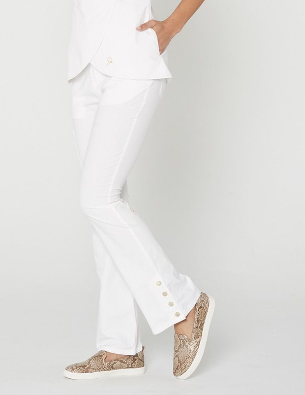 The Bootcut Pant in White is a contemporary addition to women's medical scrub outfits. Shop Jaanuu for scrubs, lab coats and other medical apparel.
