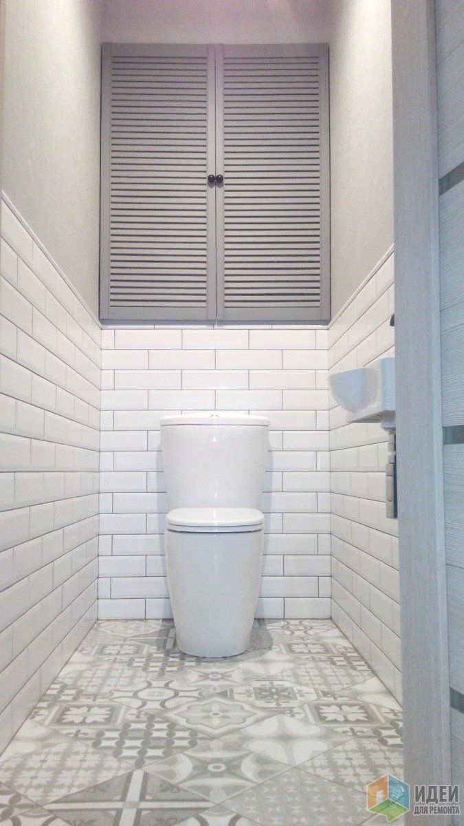 White metro tiles on the walls and patterned 'patchwork' tiles on the floor. What a great combination for a small bathroom!