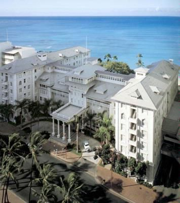 Moana Surfrider Honolulu, HI | First Hotel on Waikki Beach.  There are cushy chairs on the veranda, where you can sit 'inside/outside' and look over the beautiful courtyard, outdoor eating area, and water.  They have the BEST papaya jicama salad here