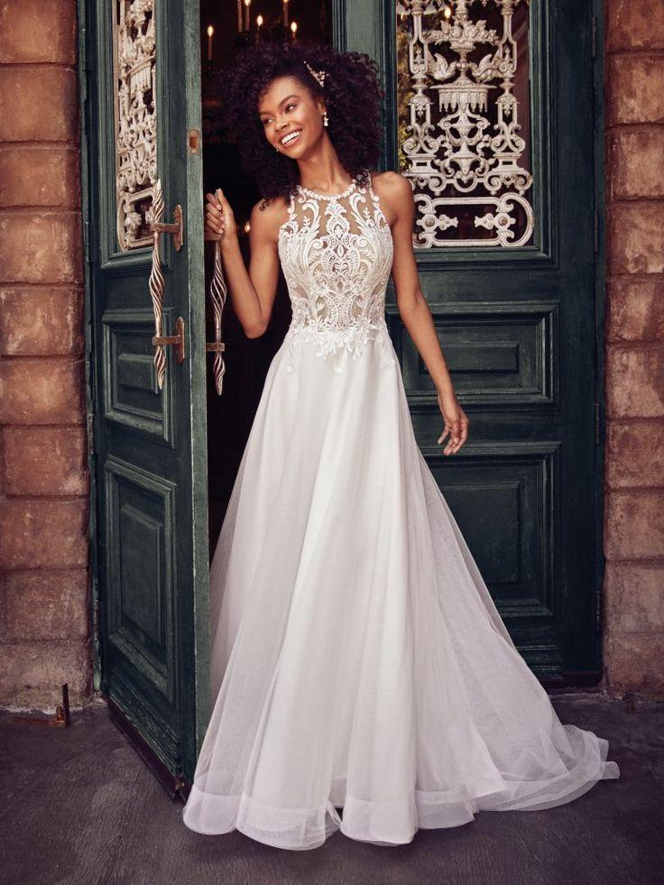 A princess wedding dress with elegant details, this slim A-line features a sheer…
