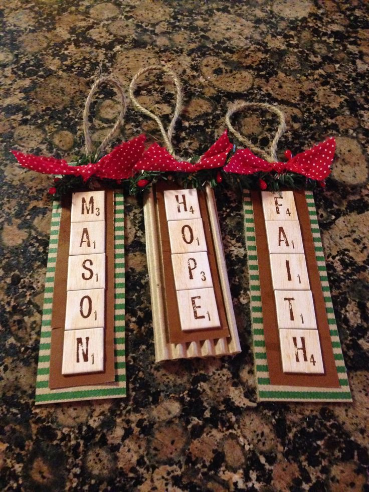 Cute Name Ornaments- scrabble tile stickers,  rusted metal sheet, and cardstock or corrugated cardboard with twine hanger and embellishments