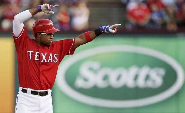 Texas Rangers Elvis Andrus celebrates hitting an RBI double, scoring Delino DeShields, during the first inning of a baseball game against the Boston Red Sox, Saturday, May 30, 2015, in Arlington, Texas. (AP Photo/Brandon Wade)