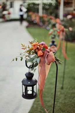 CEREMONY AND RECEPTION shepard hooks with lamps flowers orange and purple