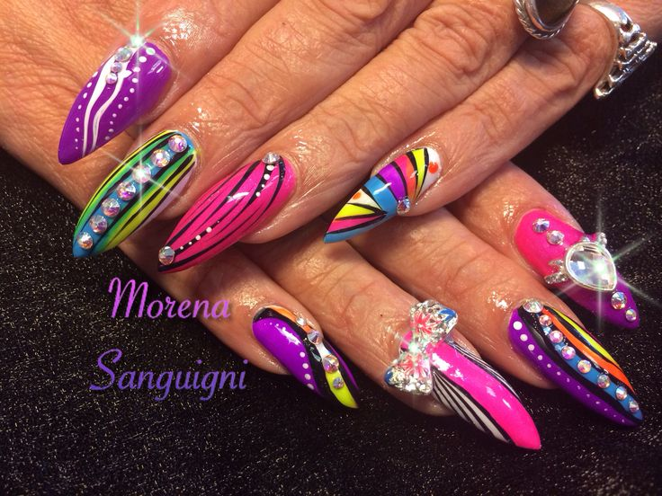 Summer stiletto nails with neon gel polish charms and swarovski crystals #nails