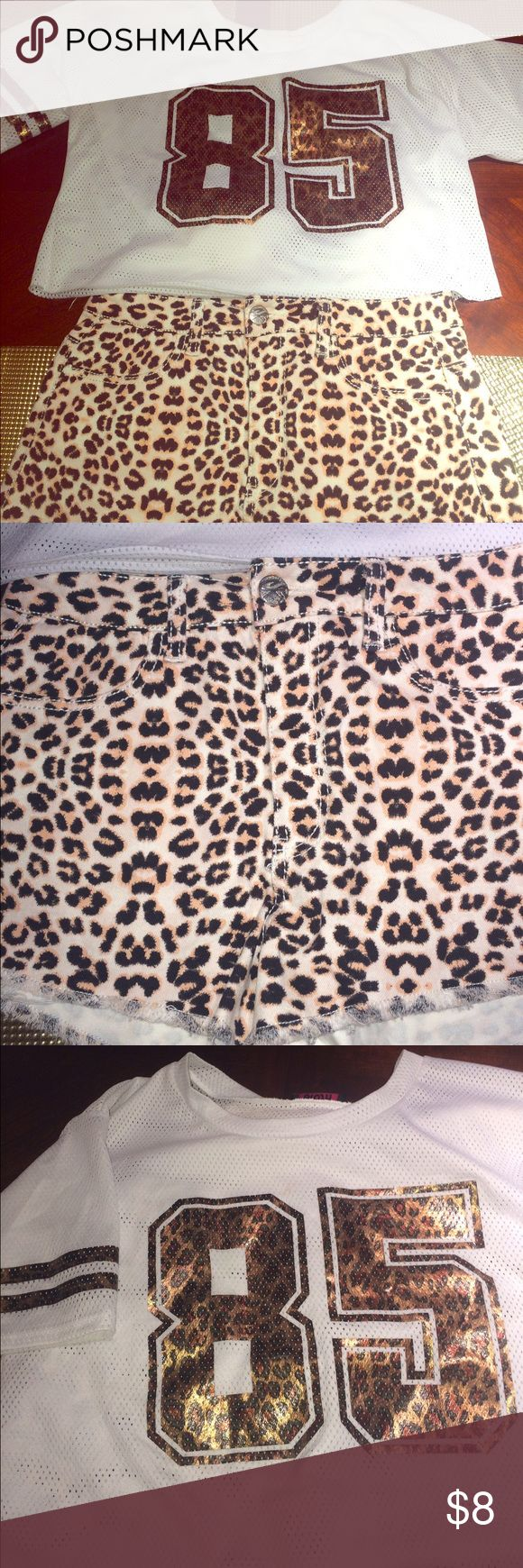 A  Set High Waisted Cheetah Shorts and Crop Top Selling Both of these Together they make a cute matching set The shirt is a jersey Crop Top with the number 84 in cheetah print  and on the sleeves two lines. The shirt is a size small. The High waisted cheetah shorts are a size 9 with a zipper and pockets on the front and back both together ONLY! is 8 Separately make me an offer Almost Famous Shorts