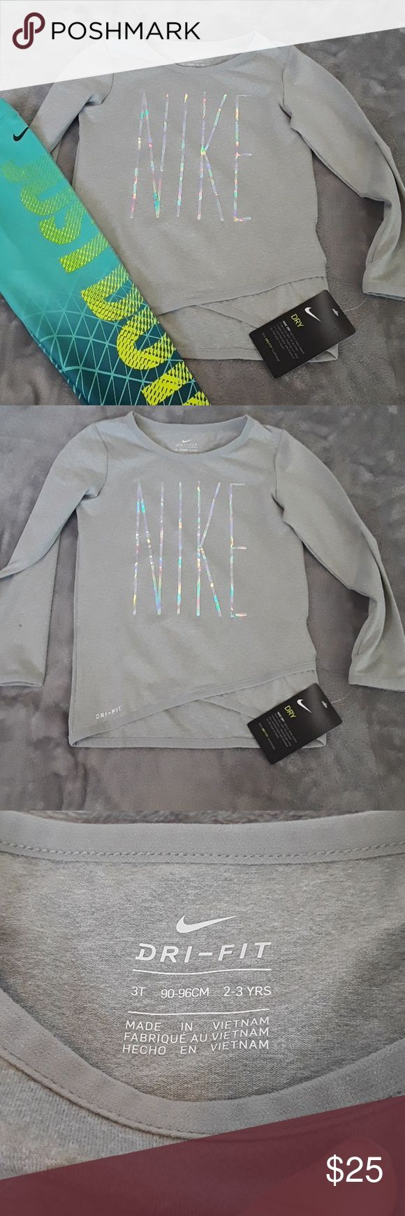 NWT Nike Top Brand new. Nike Dri Fit Top. Gray with rainbow hologram colors for lettering. Check out my other listings bundle and save! ☺ Nike Shirts & Tops