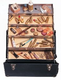 """THE PERSONAL PROPERTY OF MARILYN MONROE (CHRISTIE'S AUCTION 27-28 OCT 1999) A traveling case and makeup. The black case containing an assortment of items including lipsticks by Max Factor labeled LS/7-22/N.I., Elizabeth Arden eyeshadows """"Autumn Smoke"""" and """"Pearly Blue"""", a """"Light Green"""" eyeshadow by Leichner of London, nail polish by Revlon, one """"Cherries a la Mode"""", the other """"Hot Coral"""", """"Quintess"""" lotions by Shisheido, Anita d'Foged """"Day Dew"""" cream make-up, Erno Laszlo makeup, etc."""