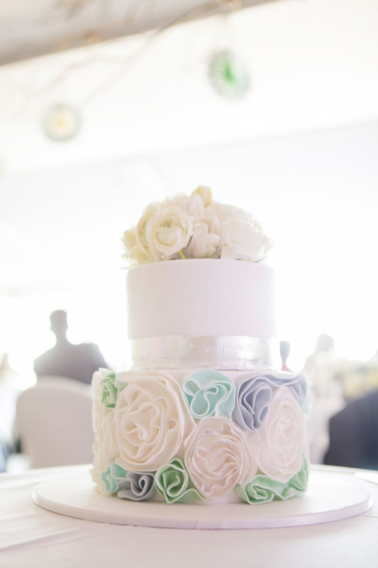 Noosa wedding cake. silver leaf, Karen Buckle photography, rolled ruffles. fresh flowers. Mondo floral designs white cake. beach themed wedding cake by Sunny Girl Cakes