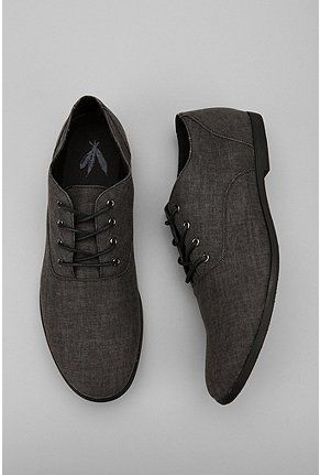 These brown canvas oxford shoes pair very well with kaki pants, jeans and a grey vest with grey sports jacket.