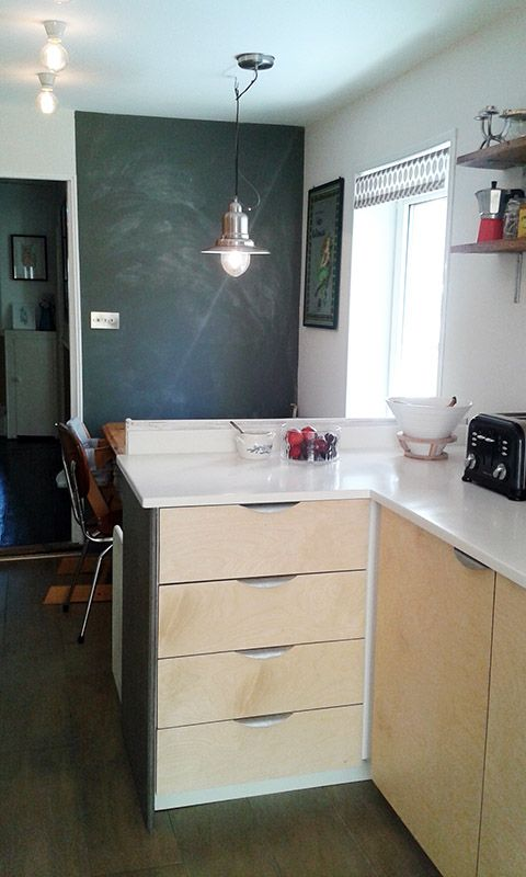 Ikea hack kitchen: Metod carcass with plywood birch ply doors. Blackboard/ chalkboard paint, and matt varnish from Ecos Paints. Marine ply floor stained with Aquateinte. White worktops.