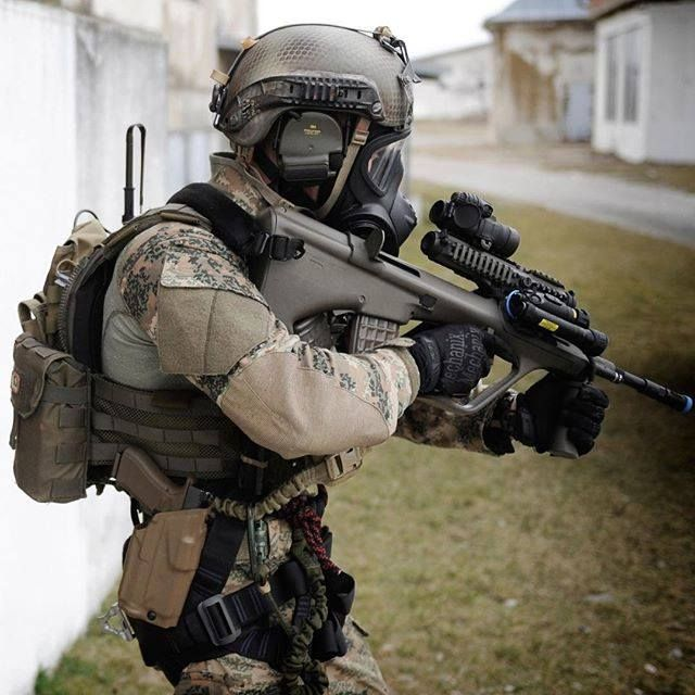 Austrian Jagdkommando operator armed with the Steyr AUG A2 assault rifle.