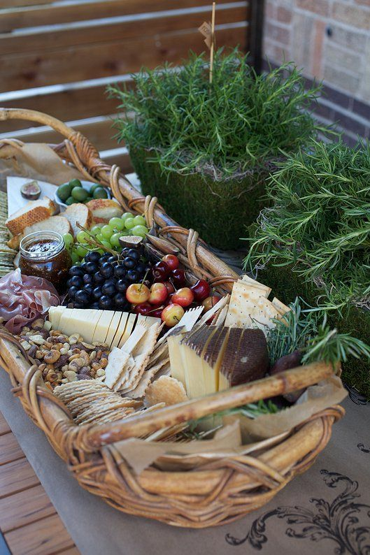 cheeseboard fixings served in oversized basket + f...