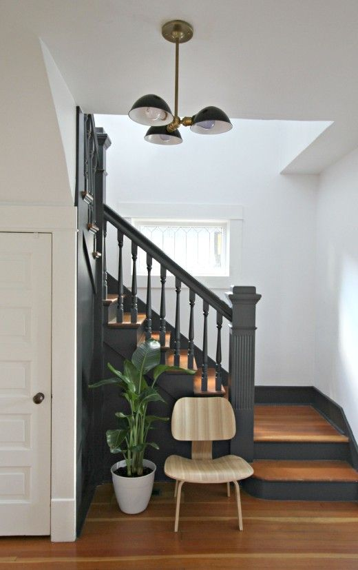 A Traditional Entryway Is Completely Modernized With Just 2 Easy Changes http://www.popsugar.com/home/How-Modernize-Staircase-Paint-40765755?utm_campaign=share&utm_medium=d&utm_source=casasugar via @POPSUGARHome