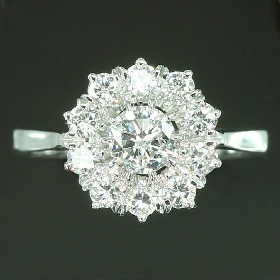 I am definitely considering something like this now. estate diamond cluster engagement ring