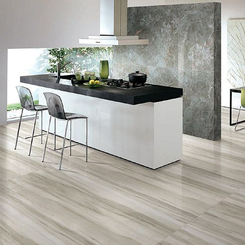 Porcel-Thin Mamara Equator and Mystic Grey marble effect thin porcelain tiles in a stylish and modern kitchen.  #kitchen #tiles #porcelain
