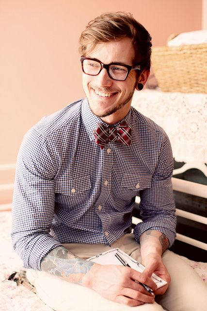Shirt by Fischer Clothing, bow tie by Campia Moda, glasses by Bon Look, pants by Chaps, and shoes by Ralph Lauren.