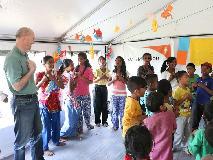 World Vision International president Kevin Jenkins meets children at a child-friendly space in the Sipadol district of Kathmandu. World Vision established child-friendly spaces to provide children with a safe place to play, learn and to receive counselling.