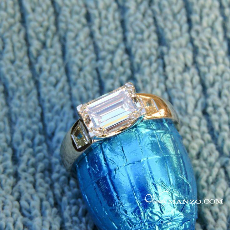 Emerald cut diamond for an Easter engagement, set horizontally in platinum band with Canary Yellow trapezoid diamonds. Custom designed and hand made. #wendymanzo #wendymanzodiamonds