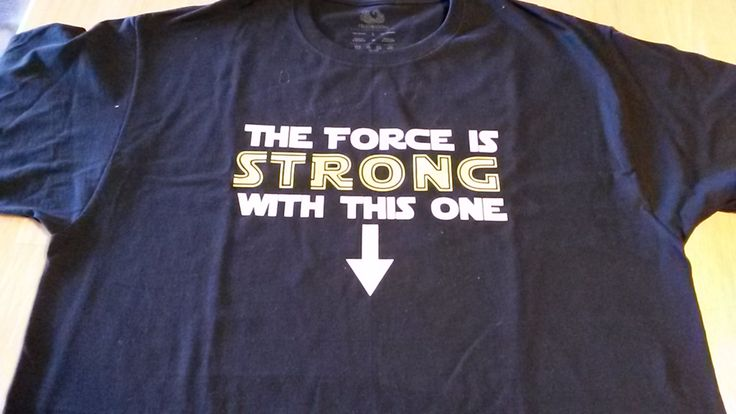 The Force is Strong with This One - t-shirt for maternity with your choice of colors and a great Star Wars font. You can change the text as well. An arrow points down to the baby.