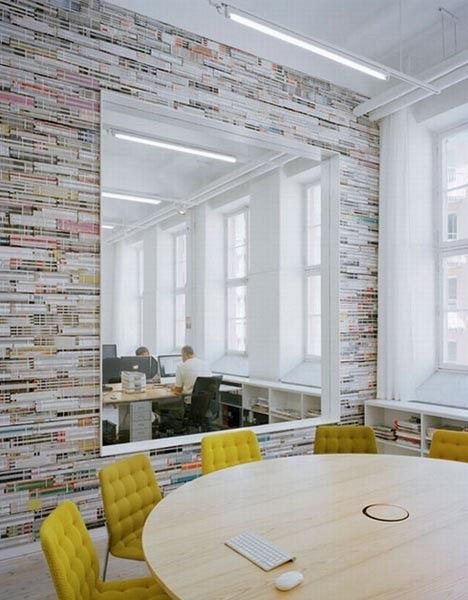 stacked magazine wall paper/ Reminds me of exposed brick