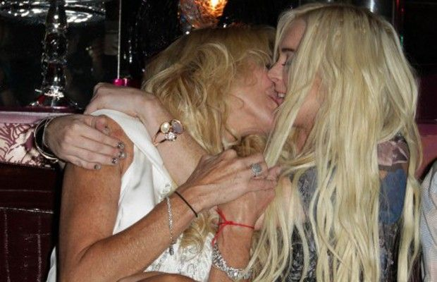 Lindsay lohan kissing her mom better, perhaps