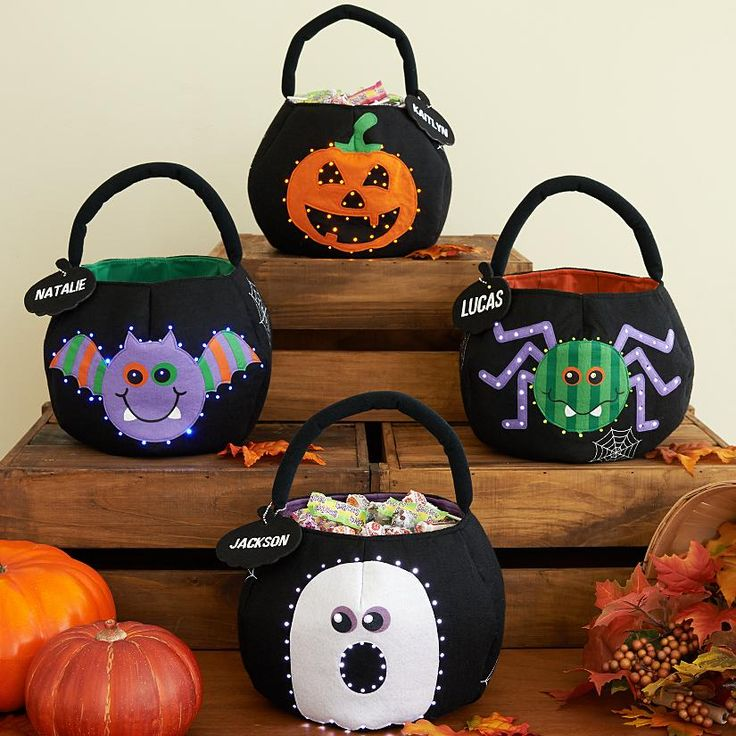 Halloween LED Treat Bag - A Personal Creations Exclusive! Trick-or-treating can be safe and fun at the same time: our felt bag features a spooky design that illuminates with sparkling LED lights at the push of a button. Available in Pumpkin, Bat, Spider or Ghost design.