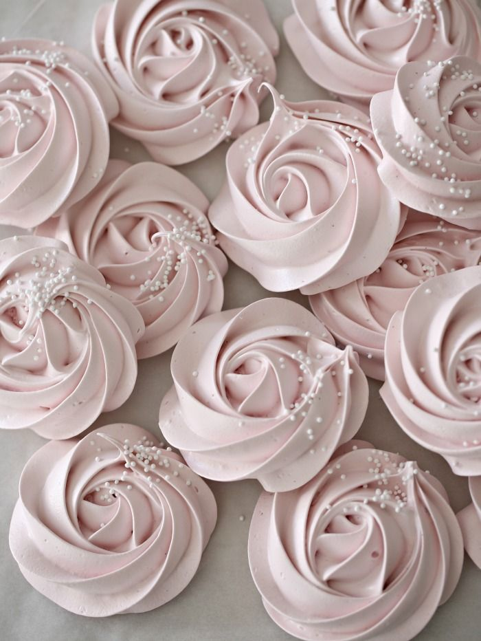 Piped rose meringues