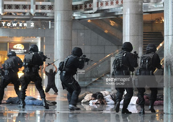 A combined Indonesian elite police forces from Densus 88 and Crisis Response Team with army Kostrad anti-terror commandos stage a mock assault on a group of 'mock terrorists' holding hostages during an anti-terror exercise at the Jakarta Stock Exchange building and other key public places in the capital on March 13, 2010. Indonesian police and the military launched a series of anti-terror exercises on Saturday, a week ahead of a visit to the country by US President Barack Obama. A series of…