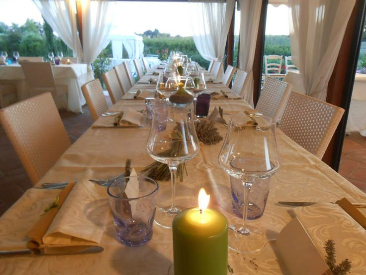 Wedding in Tuscany, romantic wedding in romantic restaurant Taverna di Bibbiano between Siena and San Gimignano. Table with candles, flowers and country-chic setting..