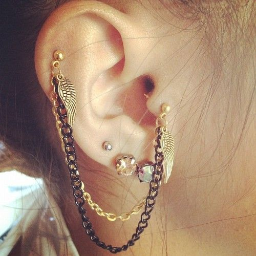Lobe, helix, and tragus piercings.
