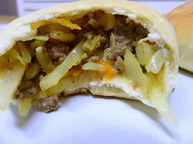 Bierocks {pronounced beer-rocks} are German meat-turnover pastries that are typically filled with cooked beef and cabbage. My husband grew up in western Kansas, where in the 1870's, the Volga Germans arrived and settled. Chris often about raves about the amazing
