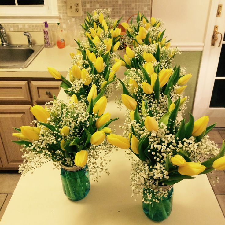 blue mason jars with yellow tulips and baby s breath make