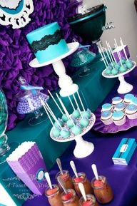 peacock colors for weddings | Purple and Teal. Peacock color table decor. Peacock wedding ideas