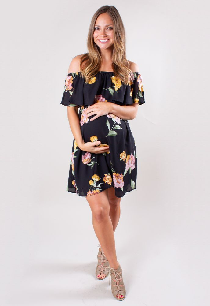 f8dd16bfc4527 This Sexy Mama Maternity black floral maternity dress screams feminine! It  has a flowy fit with a tie that can cinch around your waist to really show  off ...