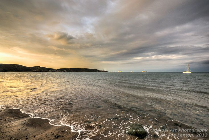 Sunset reflecting off the sea at Morfa Nefyn bay in Wales