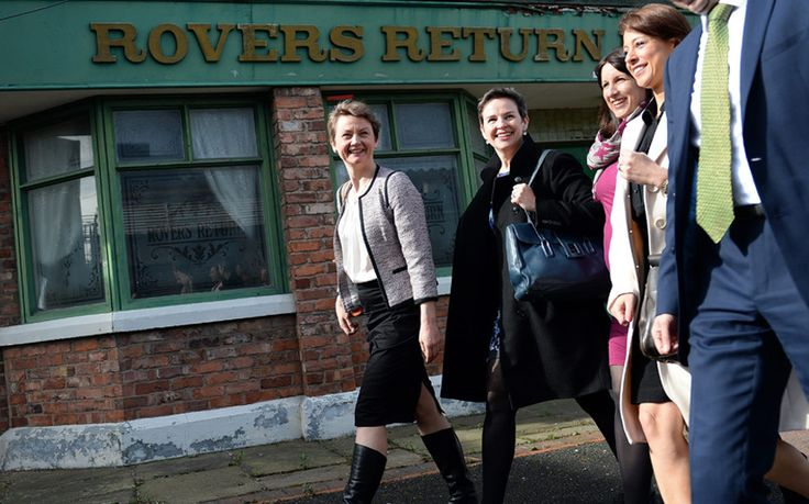 Members of the Labour Shadow Cabinet Yvette Cooper (L-R, Shadow Home Secretary), Mary Creagh (Shadow Secretary of State for International Development), Rachel Reeves (Shadow Secretary of State for Work and Pensions), Lucy Powell (MP for Manchester Central and Vice-chair of the general election campaign), and Douglas Alexander (Shadow Foreign Secretary) walk past the Rovers Return on the old Coronation Street set