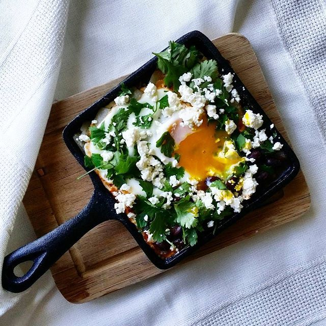 """This #breakfast will get you through the day!  Skillet potatoes fried in salted butter, salsa rojo, sheep's feta cheese, garden herbs, and a #farmfresh poached egg ~ courtesy of @hautesucre. http://feedfeed.info/breakfastEggs?img=849220 Get more breakfast egg inspiration & recipes from the Breakfast Eggs Feed on our Website 