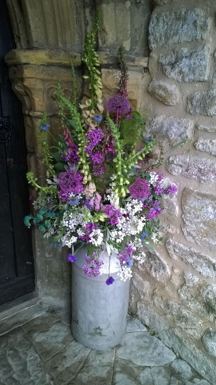 Milk churns filled with our home-grown British flowers www.theflowerfarm.co.uk