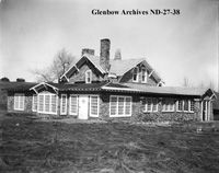 Image No: ND-27-38 Title: Stone house, Cardston, Alberta. Date: April 20, 1928 Photographer/Illustrator: Atterton Studios, Cardston, Alberta Remarks: Built by Henry Hoet between 1913 and 1929, called Cobblestone Manor.