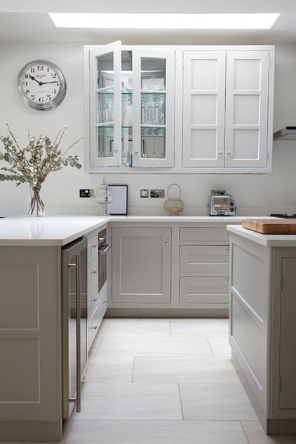 white quartz worktop Cimstone. cabinets painted in pavilion gray. Mirrors at back of glass-fronted wall cabinets.