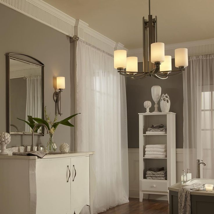 Waking up every morning in this bathroom suite is sure to brighten up your mood. The wall fixtures, chandelier and mirror are all part of Quoizel's Taylor collection. Linear style and precise design are the elements of this strong contemporary collection. #quoizellighting #contemporarydesign #contemporarylighting #homedecor #bathroomlighting