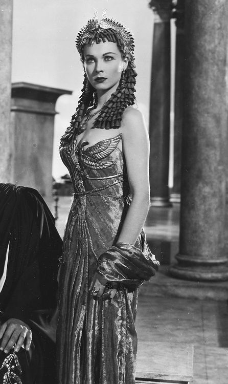 """""""Caesar and Cleopatra"""" - Vivien Leigh as Cleopatra wearing a metallic silk pleated dress and matching stole, and an elaborate headpiece."""